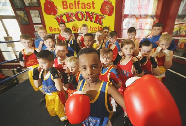 A group of children taking part in boxing training.