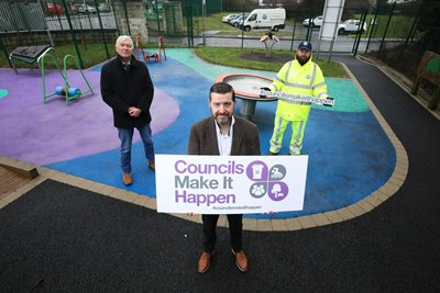 NILGA Chief Executive Derek McCallan, NILGA President Cllr Matt Garrett, and Belfast City Council Playground Inspector Brendan O'Neill at the Blacks Road Sensory Playground and Garden.